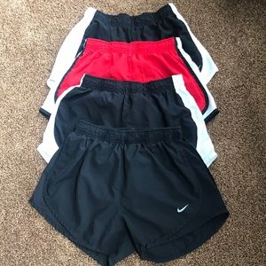 4 pair, size women's small, NIKE running shorts